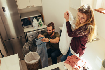 Couple setting their clothes right together