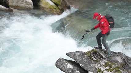 Wall Mural - Caucasian Backpacker on the River Trailhead. Slow Motion Footage