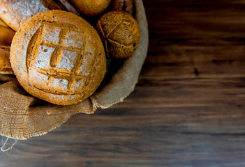 Still life photo of bread and bakery in the wicker basket. American and french toast for cooking breakfast.