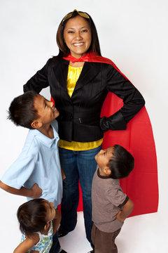 Super hero mom with her children.