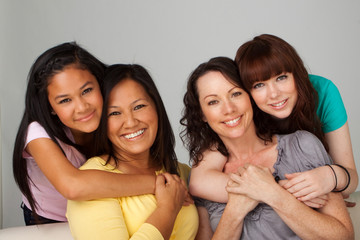 Diverse group of mothers and daughters.