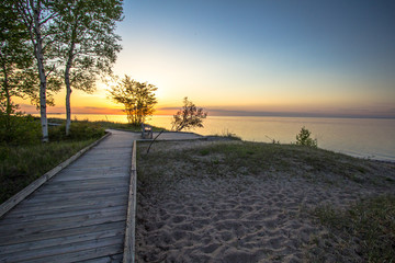 MIchigan Boardwalk Scenic Sunset. Sunset on the coast of Lake Superior in the Hiawatha National Forest. Brimley, Michigan.