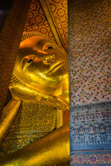 The face of the Reclining Buddha image in Wat Pho, Bangkok, Thailand