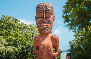 Cropped shot view of traditional Maori wood carving statue in front of Hastings library.
