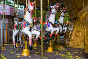 Children's carousel in the autumn.