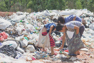 Three children find junk for sale and recycle them in landfills, the lives and lifestyles of the poor, The concept poverty, child labor and human trafficking.