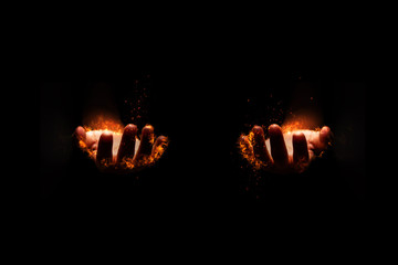 The fire was burning at the hands of both 2 side on a black background.