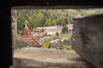 View  of the old Bran city through the slaughterhouse in the watchtower of Bran Castle. Bran city in Romania