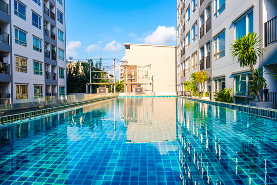 Luxury smimming pool inside of low rise condominium building