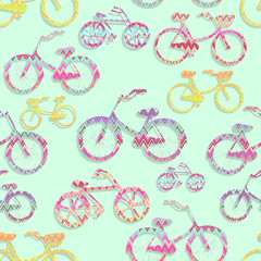 Seamless pattern with ornamented shapes of bicycles. Colorful sports design
