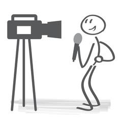 Obraz Reporter spricht vor Kamera und hält Mikrofon - fototapety do salonu