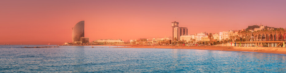 Photo sur Aluminium Corail Barceloneta Beach in Barcelona at sunrise, Spain