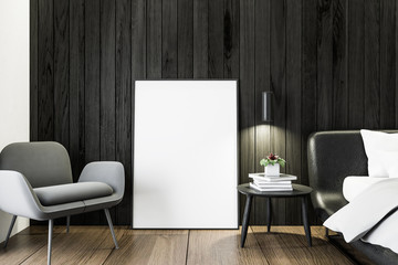 Black wooden bedroom, armchair and poster