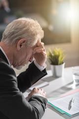 Overworked businessman having headache