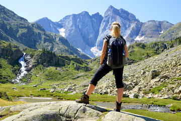 Tourist looking at the highest mountain the French Pyrenees.Vignemale massif. Occitanie in south of France.