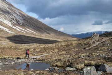 Hiking in the Scottish Highlands in Torridon along The Cape Wrath Trail towards Loch Coire Mhic Fhearchair, Highlands, Scotland, United Kingdom, Europe