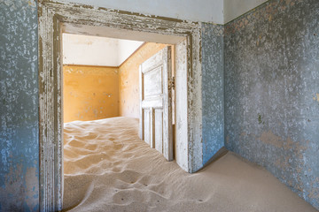 The interior of a building in the abandoned diamond mining ghost town of Kolmanskop, Namibia, Africa