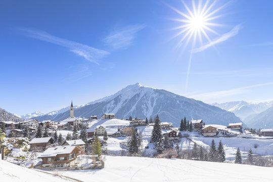 The sun shines on Davos Wiesen, Albula Valley, District of Prattigau/Davos, Canton of Graubunden