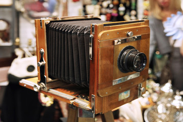 Vintage camera with an accordion at a flea market. Moscow. 07.02.2018