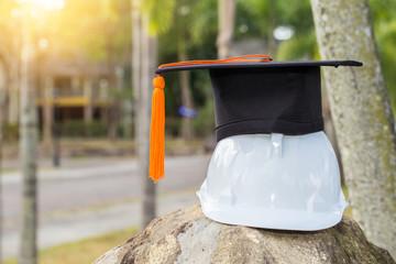 Graduation cap put on engineer safety white helmet