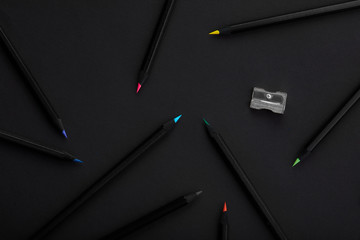 Black colored pencils on black background