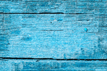 blue wood texture with bright center and dark edges background for design
