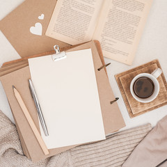 Autumn composition. Cup of coffee, book, blanket, notebook, women fashion sweater. Flat lay, top view, copy space