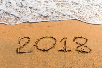 2018 on a beach sand