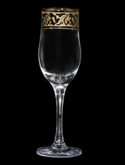 Wineglass on a black background.