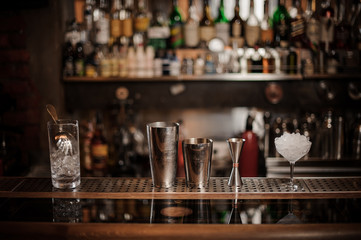 Set of necesary barman equipment on the bar counter