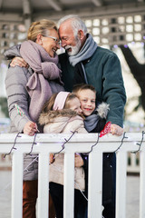 Grandparents enjoying with their grandchildren in city park.