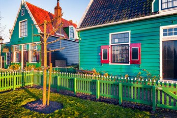Sunny spring scene in Zaanse Schans. Beautiful morning view of typical Dutch building, Zaandam village location, Netherlands, Europe. Beauty of countryside concept background.