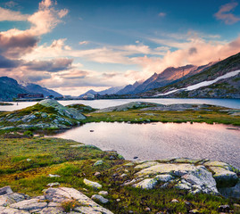Colorful summer evening on the Totensee lake on the top of Grimselpass