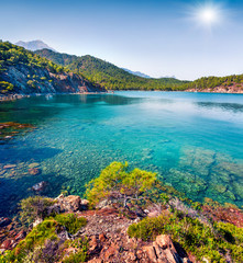 Splendid Mediterranean seascape in Turkey. Sunny view of a small azure bay near the Tekirova village, District of Kemer, Antalya Province.