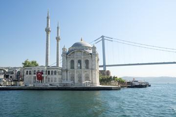 Ortakoy mosque and July 15 Martyrs' Bridge formerly known as Bosphorus Bridge, Istanbul, Turkey.