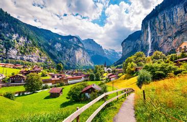 Sunny summer view of great waterfall in Lauterbrunnen village Fototapete