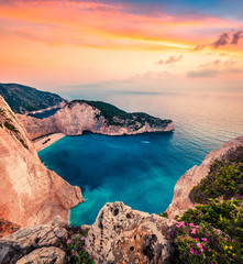 Fabulous spring scene on the Shipwreck Beach. Colorful sunset on the Ionian Sea, Zakinthos island, Greece, Europe. Beauty of nature concept background. Artistic style post processed photo.