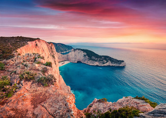 Dramatic spring scene on the Shipwreck Beach. Colorful sunset on the Ionian Sea, Zakinthos island, Greece, Europe. Beauty of nature concept background. Artistic style post processed photo.