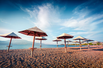 First warm days on the Nafpaktos beach. Sunny spring seascape of Corinth Gulf. Splendid morning scene of Greece resort. Vacation concept background.