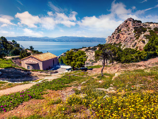 Sunny spring view of Agios Ioannis Church. Splendid morning view of West Court of Heraion of Perachora, Limni Vouliagmenis location, Greece, Europe. Traveling concept background.