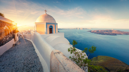 Sunny morning panorama of Santorini island. Picturesque spring sunrise on the famous Greek resort Thira, Greece, Europe. Traveling concept background. Artistic style post processed photo. Wall mural