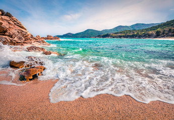 Sunny summer seascape of Aegean Sea. Beautiful marine landscape of Cuba Beach, Olimpiada village location, Greeace, Europe. Beauty of nature concept background.