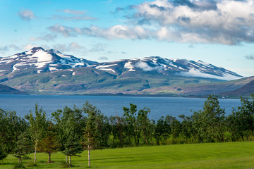 idyllic view in akureyri iceland with typical icelandic landscape