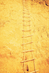 Rope ladder on the beach on a summer sunny day, vertical image orientation