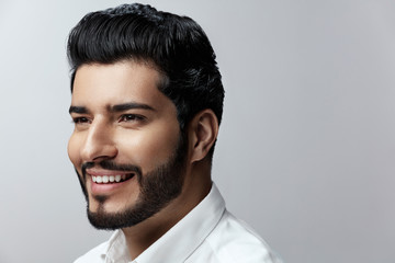 Hair And Beard. Beautiful Smiling Man With Hair Style