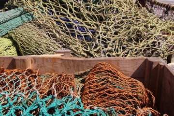 Fisherman's net are drying on the quay in the harbor of Urk in Netherlands.