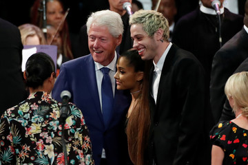 Former U.S. President Bill Clinton poses with singer Ariana Grande and her boyfriend Pete Davidson as they attend the funeral service for Aretha Franklin at the Greater Grace Temple in Detroit