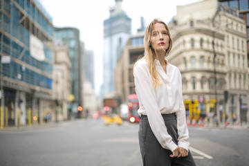 Charming woman standing in the street