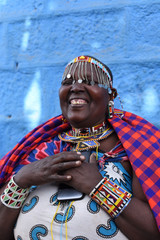 Smiling Masai woman who just received money on her phone