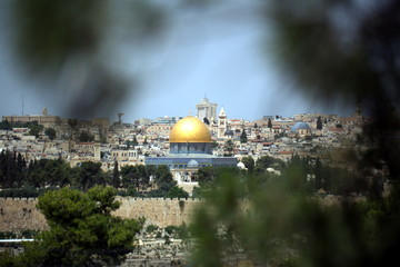 view of the old city of Jerusalem in Israel with an olive mountain. the golden dome of the Moslem mosque